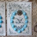 花モチーフボタン1つとガラスボタン11個のセット