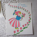 女の子とチューリップのイースターカード