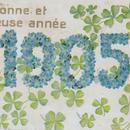勿忘草と四つ葉で飾られた1905年の新年ポストカード 1