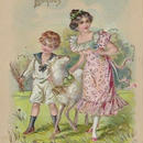 男の子と女の子とヤギのイースターポストカード