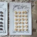 パールオブマザースタイルのクリーム色ボタンシート24個