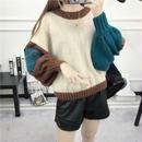 つぎはぎの用のようなデザインがかわいいセーター