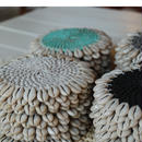 COASTER rattan with cowrie shells