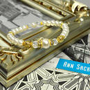 コットンパールホワイト8ミリ、人工パール6ミリ、カット水晶6ミリ、透かし金具、ロンデル金具、花金具