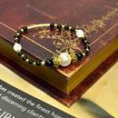 コットンパールホワイト10ミリ、クラック水晶6ミリ、オニキス・6ミリ、メタル金具