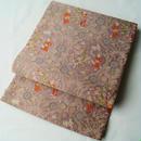【ふくろ帯】梅鼠色 織り 変わり更紗文