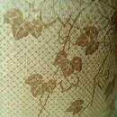 【単衣】アースカラー草花文の国産本漆染め紬