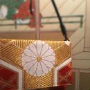京都産正絹 帯のクラッチバッグ  橙色金糸刺繍  華丸菱形文様  葵