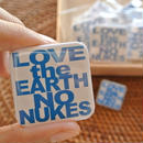 LOVE the EARTH NO NUKES tin badge
