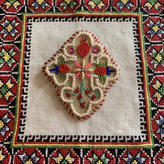 beads cross brooch