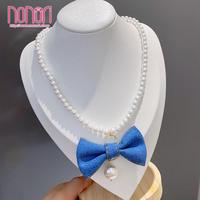 蝶結びペンダント模造真珠ネックレス