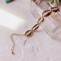 gold shell bracelet