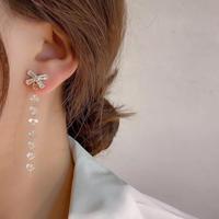 ribbon clear stone long pierce/earring