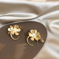 mat gold flower hoop pierce