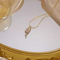 key gold necklace