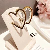 heart × pearl hoop pierce