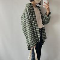 Over green check shirt