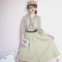 vintage center button design trench skirt