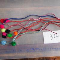 アジア民族衣装 はぎれ リス族ボンボンno.34  30センチ紐 10本セット 刺繍布 山岳民族 タイ 手芸材料 古布 手縫い紐 奇跡