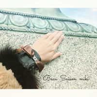 Blacelet using  Crocodile leather color of black and brown feather