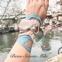 Bracelet using  crocodile leather color of pink with race and ribbon
