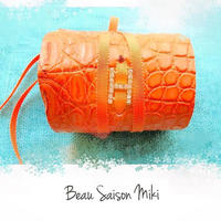 Bracelet using  crocodile leather color of orange with ribbon and Rhinestone