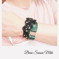 Bracelet made from green color crocodile leather with floral lace
