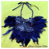 Necklace using swalovesky , race , Crocodile leather and dark blue feather