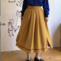 lady's mustard color skirt