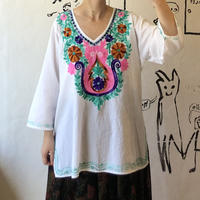 lady's colorful embroidery tops