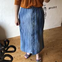 lady's light blue skirt
