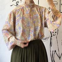 lady's pastel color blouse