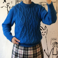 lady's blue cable knitting sweater