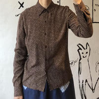 lady's brown base patterned blouse