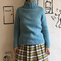 lady's pastel blue turtle neck sweater