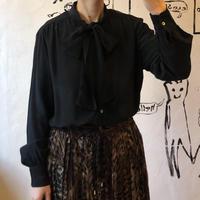 lady's black color bow tie blouse