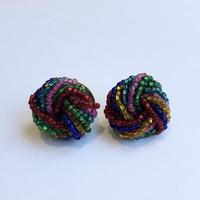 lady's colorful beads pierce