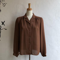 lady's brown open collar blouse
