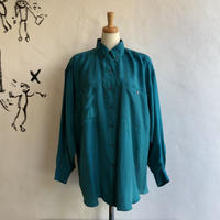 lady's green color silk material blouse