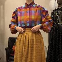 lady's plaid pattern blouse