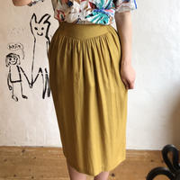 lady's yellow cocoon silhouette skirt