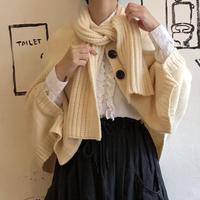 lady's white knit poncho