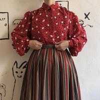 lady's patterned blouse