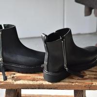 Feit.    chunky metal zip boots