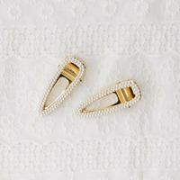 small pearl big clip