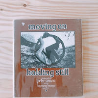 MOVING ON HOLDING STILL    PETER SIMON