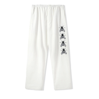 BUTTER GOODS  SWARM EMBROIDERED PANTS- WHITE