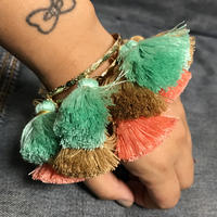 Chunky tassels bangle w peace charms