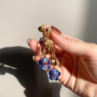gold ring blue flower
