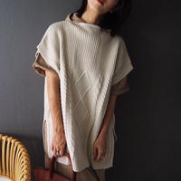 oversized cable-knit vest